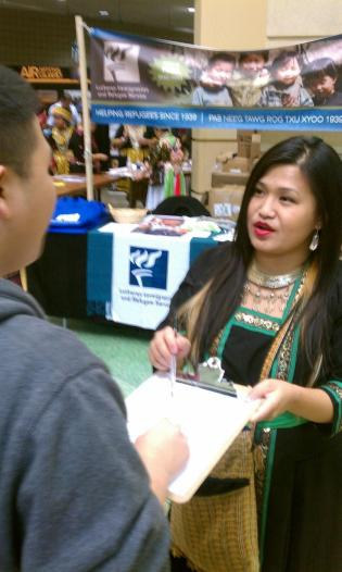 Linda Hawj canvassing at the St. Paul Hmong New Year about the 2012 Election.